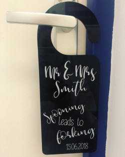 image of wedding night door hanger