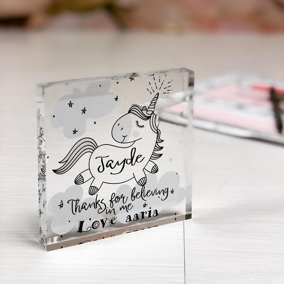 a picture of a personalised teacher unicorn design acrylic block