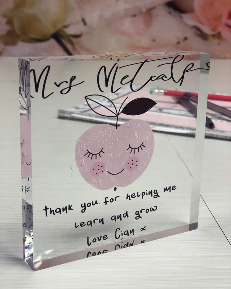 a picture of a personalised teacher apple acrylic block