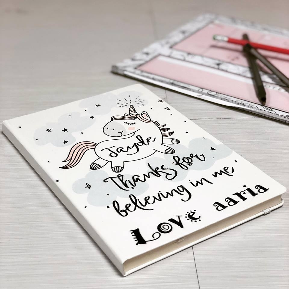 image of a personalised unicorn design notebook