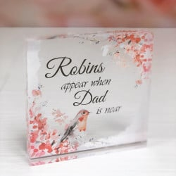 Image of robins appear remembrance plaque