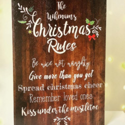 Image of christmas family rules sign